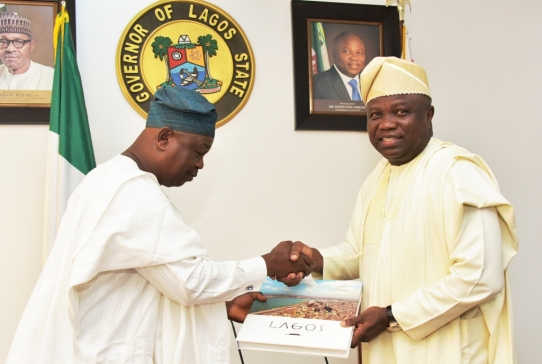 Lagos State Governor, Mr. Akinwunmi Ambode (right), presents a souvenir to President, NASFAT, Alhaji Mohammed-Kamil Yomi Bolarinwa (left) during a courtesy visit by Leaders of NASFAT Islamic Group at the Lagos House, Ikeja, on Thursday, November 30, 2017.